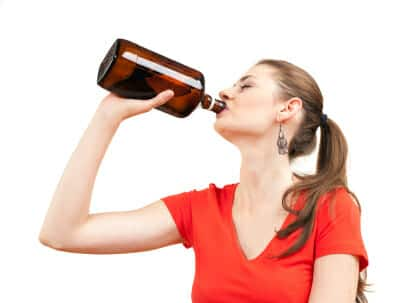 alcoholic woman drinking with bottle