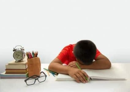 33087526 - tired child lying and sleeping on the books