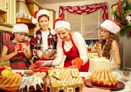 47866302 - happy christmas family preparing a cake