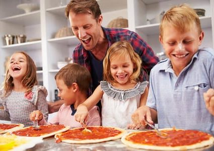 41461635 - father making pizza with his kids