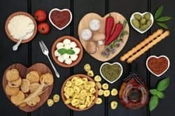 52585656 - mediterranean healthy diet food selection over dark wood background.