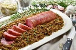 70088820 - cotechino with lentils with rosemary served on a plate with some ingredients