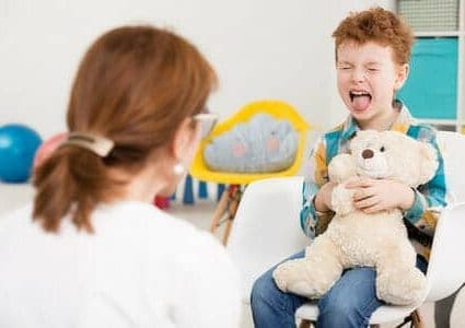 56111102 - naughty young boy with adhd screaming at psychologist's office