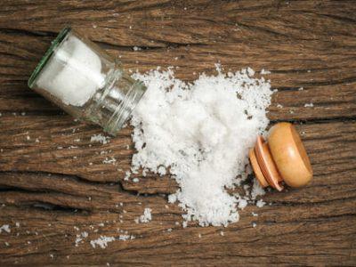 41934663 - salt sprinkled on wooden table