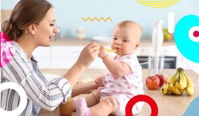 Cosa non fare durante lo svezzamento, mamma che imbocca la figlia di 6 mesi - alimentazionebambini. It by coop
