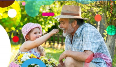 L'importanza dei nonni per i nipoti, bimba che raccoglie i fiori con nonno - alimentazionebambini. It by coop